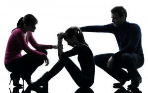 parents in relationship counseling with an unruly teenager